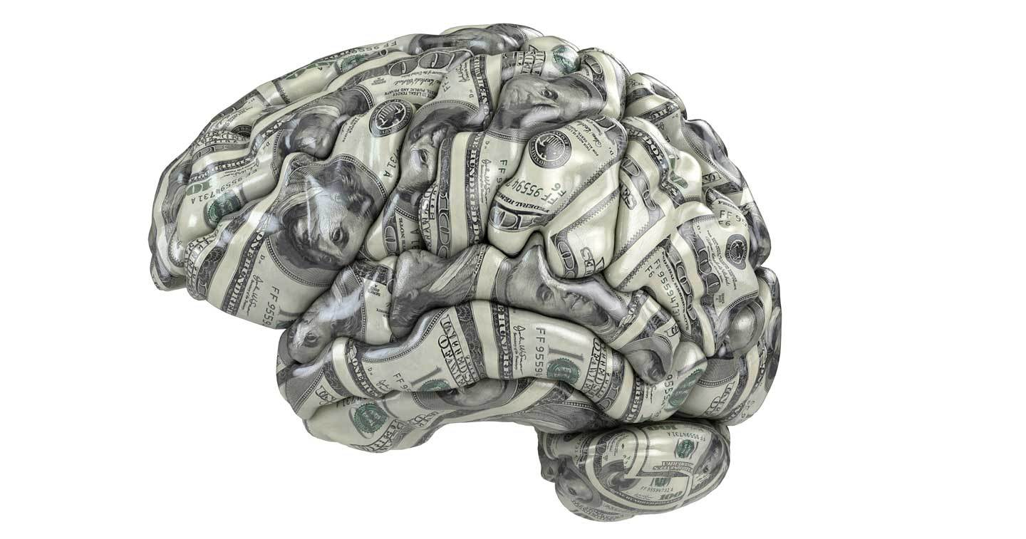 dollar bills shaped into a brain