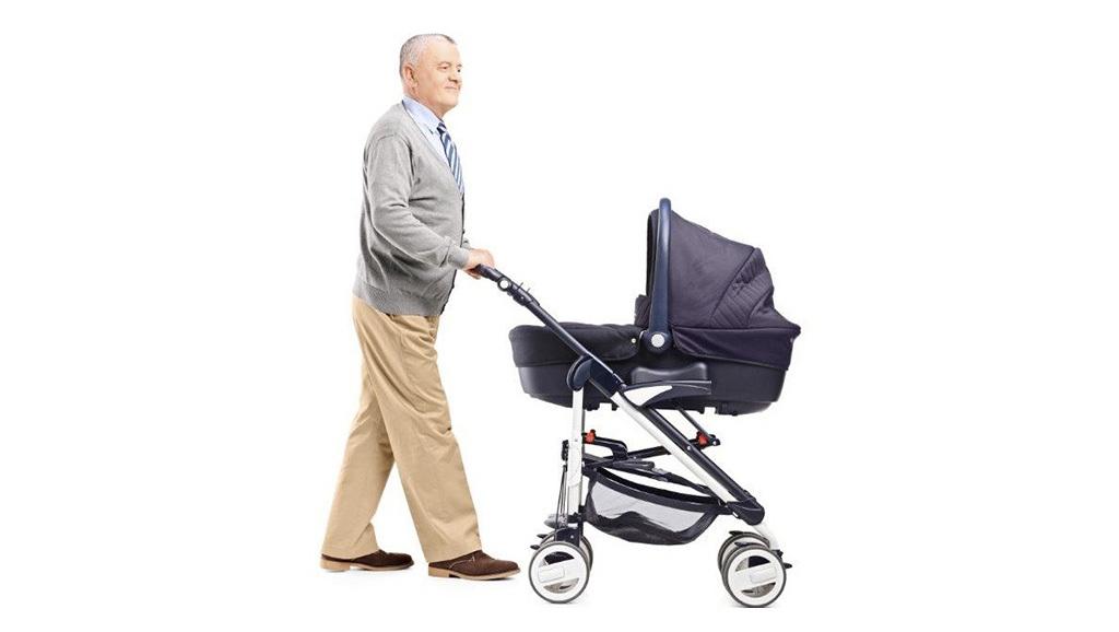 Older man pushing a pram