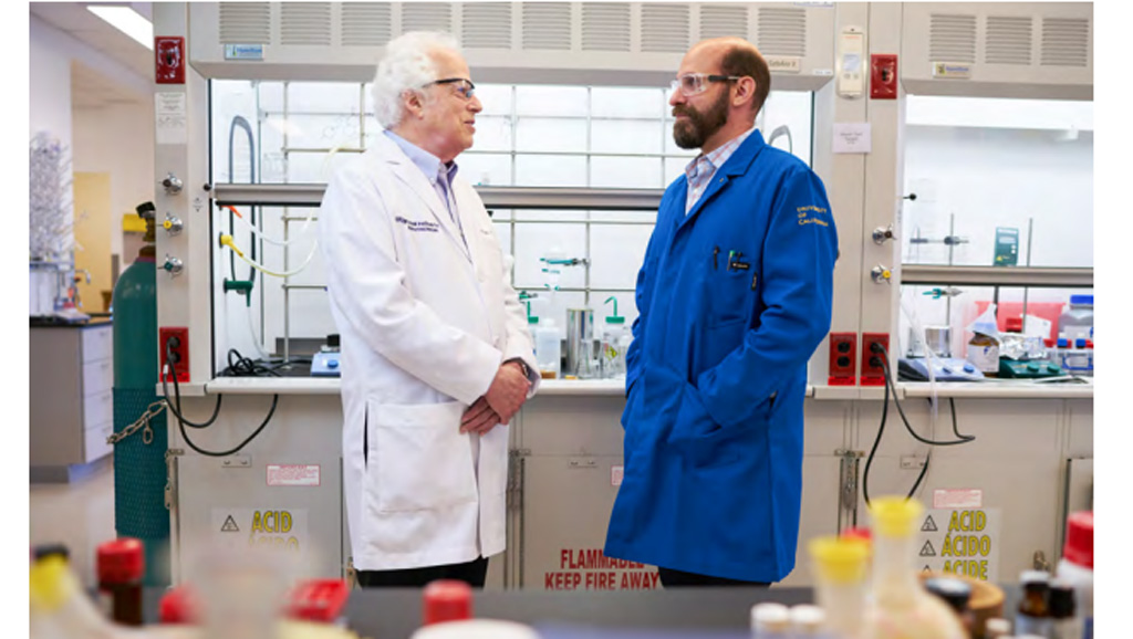 Stanley Prusiner in his lab, with fellow researcher Nick Paras
