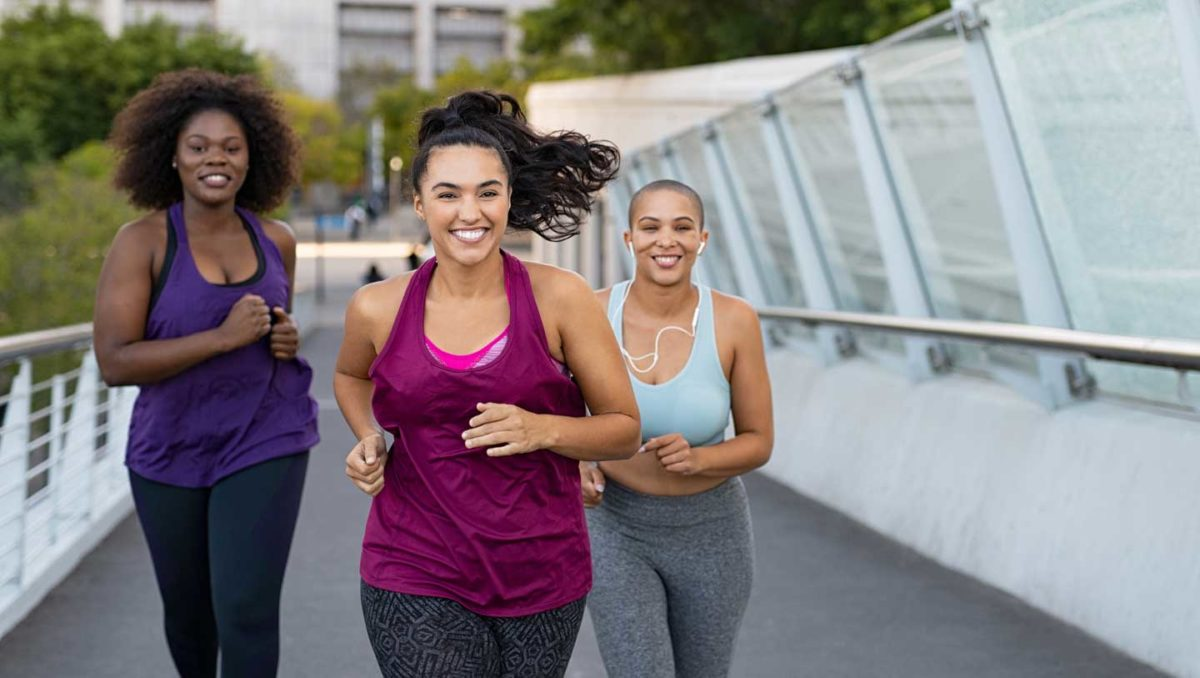 Trio running on a bridge