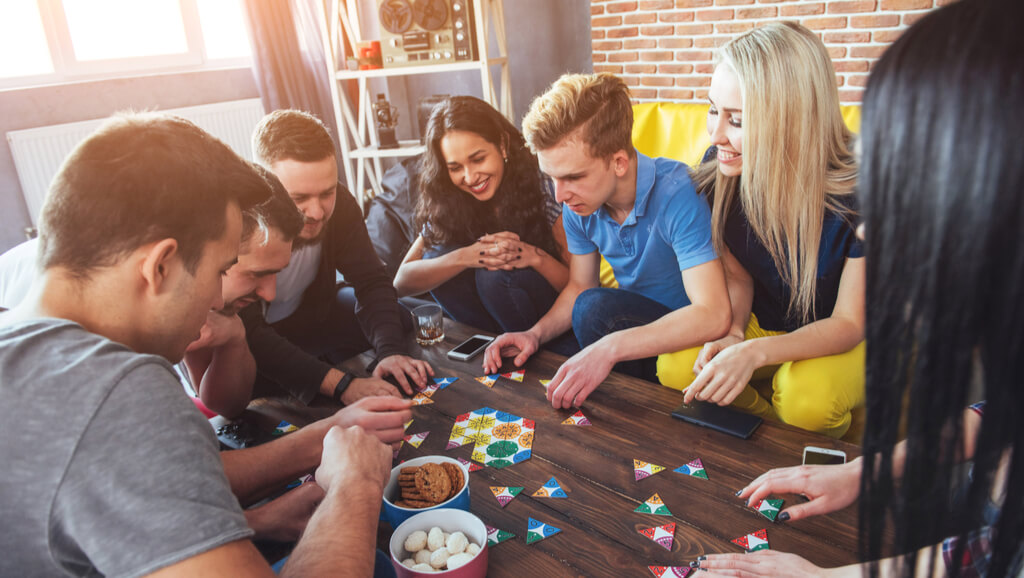 People cooperating on a board game